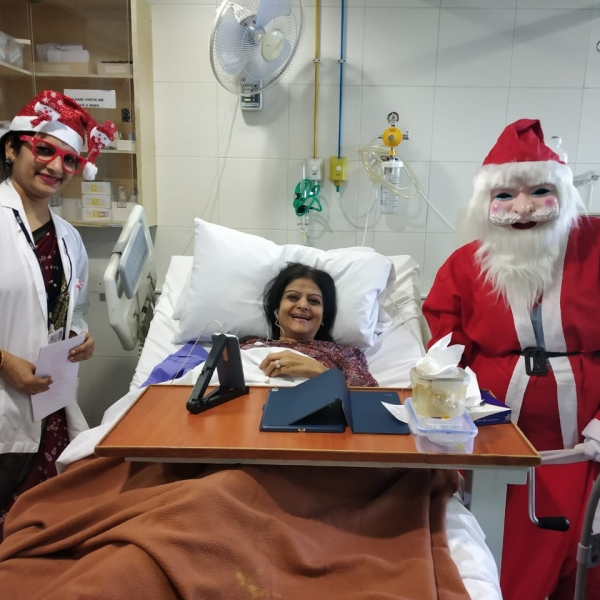 Director Nursing- Ms. Prajakta Hindlekar greeting patients with Santa.