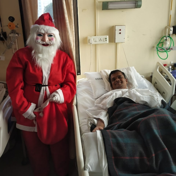 Santa Greeting patient's in in-patient area.